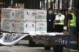 Workers transport Moderna vaccines against the COVID-19 shipped from the United States, to Taiwan Air Cargo Terminal at the Taoyuan International Airport in Taoyuan, Taiwan, June 20, 2021.