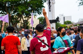One protester holds up three-finger salute during anti-government protests, Bangkok, Thailand