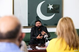 Pakistan's Interior Minister Sheikh Rasheed Ahmad speaks to reporters at the Pakistani embassy in Kuwait City on May 31, 2021. …