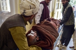 In this photo taken on June 3, 2021, a patient lies on a stretcher before receiving treatment controlled by Taliban militants…