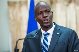 (FILES) In this file photo former Haitian President Jovenel Moise speaks at the swearing in ceremony for Prime Minister Jack…