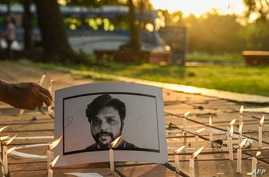 Candles are placed by journalists next to the portrait of Reuters journalist Danish Siddiqui as a tribute in Kolkata on July 16…