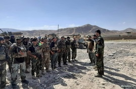 FILE PHOTO: Afghan commandos arrive to reinforce security forces in Faizabad, capital of Badakhshan province, after the Taliban…