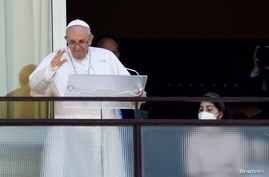 Pope Francis leads the Angelus prayer from a balcony of the Gemelli hospital, as he recovers following scheduled surgery on his…