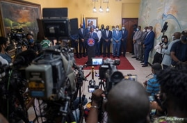 Interim Prime Minister Claude Joseph gives a press conference almost a week after the assassination of President Jovenel Moise,…