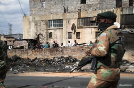 Members of the military patrol through the streets of Alexandra township as the country deploys the army to quell unrest linked to the jailing of former President Jacob Zuma, in Johannesburg, South Africa, July 15, 2021.