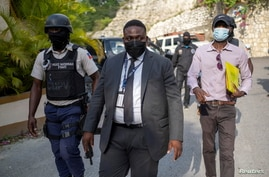Carl Henry Destin, a Haitian justice of the peace, leaves the residence of late President Jovenel Moise after FBI agents assisted with investigations inside the property in Port-au-Prince, Haiti, July 15, 2021.