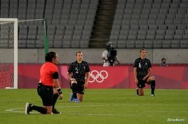 Jul 21, 2021; Chofu, Japan; New Zealand players including midfielder Ria Percival (2) and defender Abby Erceg (8) kneel before…