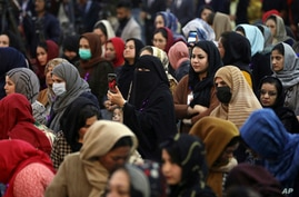FILE - Afghan women attend an event to mark International Women's Day in Kabul, Afghanistan.