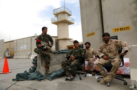 Afghan security forces keep watch after the American military left Bagram air base, in Parwan province north of Kabul,…