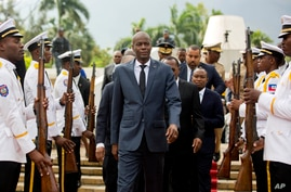 FILE - Haiti's President Jovenel Moise, center, leaves during a national ceremony in Port-au-Prince.