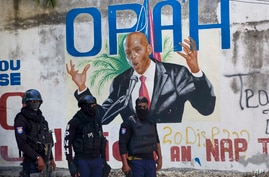 Police stand near a mural featuring Haitian President Jovenel Moise, near the leader's residence where he was killed by gunmen…