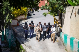 Security forces investigate the perimeters of the residence of Haitian President Jovenel Moise, in Port-au-Prince, Haiti,…