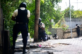 Police search the Morne Calvaire district of Petion Ville for suspects who remain at large in the murder of Haitian President…
