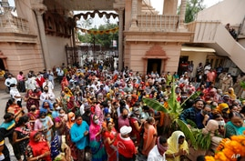 Devotees wait to offer prayer at Lord Jagannath temple ahead of annual Rath Yatra or chariot procession in Ahmedabad, India, July 10, 2021.