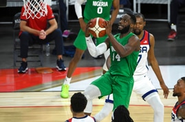 Nigeria's Ike Nwamu (34) shoots against the United States during an exhibition basketball game Saturday, July 10, 2021, in Las…