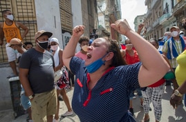 A woman shouts pro-government slogans as anti-government protesters march in Havana, Cuba, July 11, 2021.