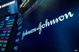 The Johnson & Johnson logo appears above a trading post on the floor of the New York Stock Exchange, Monday, July 12, 2021.