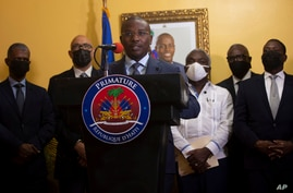 Interim Prime Minister Claude Joseph gives a press conference in Port-au-Prince, Tuesday, July 13, 2021. A picture of late…