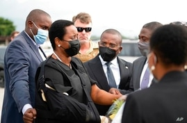 In this handout photo released by Haiti's Secretary of State for Communication, Haiti's first lady Martine Moise, wearing a…