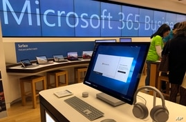 FILE - In this Jan. 28, 2020, file photo, a Microsoft computer is among items displayed at a Microsoft store in suburban Boston…
