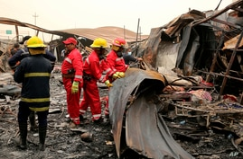 Recovery workers look for bodies after a blaze ripped overnight through a COVID treatment ward at the Imam Hussein Teaching Hospital, in Nasiriyah, Iraq, July 13, 2021.