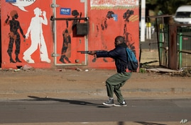 Metro police take aim on people who took part in a protest, at a shopping center in Soweto, near Johannesburg, South Africa, July 13, 2021.