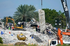Search and rescue crews work at the site of the collapsed Champlain Towers South condo building after the remaining structure was demolished, in Surfside, Florida, July 5, 2021.