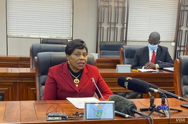 FILE - Monica Mutsvangwa, Zimbabwe's information minister, talks to reporters in Harare, July 06, 2021. Mutsvangwa says a recent spike in COVID-19 cases has forced authorities to ask all government workers to be vaccinated. (ColumbusMavhunga/VOA)