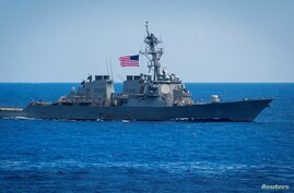 FILE - Guided-missile destroyer USS Benfold sails in the Philippine Sea, June 15, 2018. (Sarah Myers/U.S. Navy/Handout via Reuters)