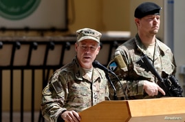 FILE - Commander of U.S. and NATO forces in Afghanistan, U.S. Army General Scott Miller, speaks during a change of command ceremony in Kabul, Afghanistan, Sept. 2, 2018.