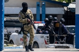 A Haitian Army troop guards the entrance of the General Directorate of the police where the suspects of the assassination of President Jovenel Moise are detained, in Port-au-Prince, July 10, 2021.