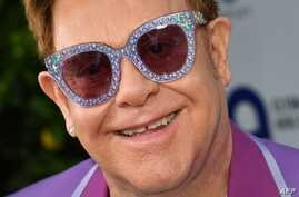 Singer-songwriter Elton John poses on the red carpet upon his arrival for the midsummer party of his AIDS Foundation, in Cap d'Antibes, near Antibes, southern France, July 24, 2019.