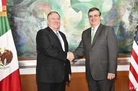 Photo released by the Mexican Foreign Ministry shows Mexican Foreign Minister Marcelo Ebrard, right, shaking hands with  US Secretary of State Mike Pompeo during a meeting in Mexico City on July 21, 2019.