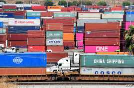 (FILES) In this file photo taken on August 23, 2019, container trucks arrive at the Port of Long Beach in Long Beach, California.  Washington is moving ahead on September 1, 2019, with new tariffs on Chinese imports as it steps up a high-pressure…