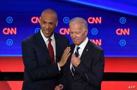 Democratic presidential hopefuls Former Vice President Joe Biden (R) and US Senator from New Jersey Cory Booker chat during a break in the second round of the second Democratic primary debate of the 2020 presidential campaign season hosted by CNN at…