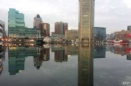 "Baltimore is reflected in a still and icy Inner Harbor, Jan. 31, 2014. US President Donald Trump attacked Rep. Elijah Cummings, a Baltimore Democrat, and branded the majority black city of Baltimore an ""infested mess,"" July 27, 2019."