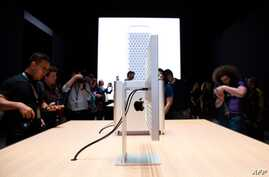 (FILES) In this file photo taken on June 03, 2019 Apple's new Mac Pro sits on display in the showroom during Apple's Worldwide Developer Conference (WWDC) in San Jose, California. Apple said Monday it would keep making its Mac Pro in the United…