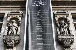 TOPSHOT - A banner listing the names of victims of household violence hangs from the Paris city hall during a protest action dedicated to the memory of the women killed by their spouse or ex-spouse since the beginning of the year and against the…