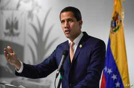 Venezuelan opposition leader and self-proclaimed acting president Juan Guaido speaks during a press conference in Caracas, on…