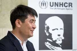 Nansen Prize laureate Kyrgyzstan's human rights lawyer Azizbek Ashurov looks on after a press conference on Oct. 2, 2019 in Geneva.