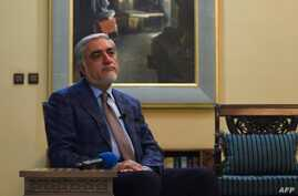 Afghan presidential candidates Abdullah Abdullah looks on as he speaks during an interview with AFP at the Sapedar Palace in…