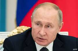Russian President Vladimir Putin chairs a meeting of the Pobeda (Victory) Organising Committee at the Kremlin in Moscow on…