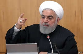 A handout picture provided by the Iranian presidency shows the Islamic republic's President Hassan Rouhani chairing a cabinet…