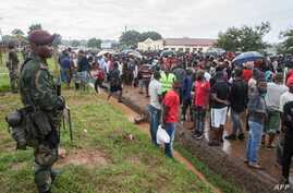 Malawi Defence Force stand by as they watch protesters in Lilongwe on January 16, 2020, during a protests at alleged attempts…