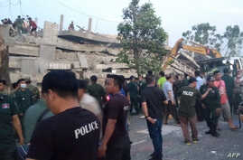 Rescuers look for trapped workers after a seven-storey building under construction collapsed in southern Cambodia's coastal Kep…
