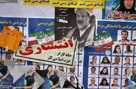 TOPSHOT - Iranian electoral posters and fliers are pictured on the last day of election campaign in Tehran on February 19, 2020…
