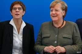 (L-R) The leader of the Christian Democratic Union (CDU) Annegret Kramp-Karrenbauerand German Chancellor Angela Merkel pose…