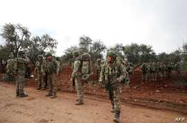 Turkish soldiers gather in the village of Qaminas, about 6 kilometres southeast of Idlib city in northwestern Syria, Feb. 10, 2020.