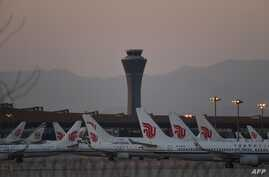 Air China planes are seen on the tarmac at Beijing Capital Airport in Beijing amid the ongoing COVID-19 coronavirus outbreak on…